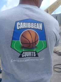 Bob Whyte in Barbuda, showing off a Caribbean Courts shirt.
