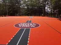 Frost Valley YMCA logo in middle of epic multiple game basketball court.