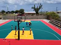 Replacement tennis and basketball courts in Codrington, Barbuda, courtesy of Australia, the Red Cross, and community effort, part of the ongoing recovery from hurricane Irma. Shown here before, with visiting goats.
