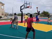Replacement tennis and basketball courts in Codrington, Barbuda, courtesy of Australia, the Red Cross, and community effort, part of the ongoing recovery from hurricane Irma.Shown here, the new tennis court.