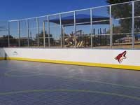 Photo from Scottsdale, Arizona installation of inline skating hockey rink for NHL Coyotes and the Boys and Girls Club, at Laguna Elementary. Removal of old surface, prep, installation of Versacourt IceCourt Outdoor Speed tile, and finished surface with custom logos.