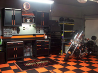 Sample picture of a workshop area installed with orange and black tile floor designed to support vehicle and equipment weights.